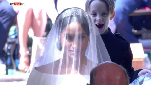 An excited Mulroney twin helps Meghan Markle into the chapel on Saturday.