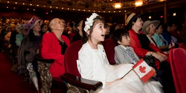 Ailish Chung, 10, reacts to seeing Meghan Markle as people gather to watch her Royal Wedding to Prince...