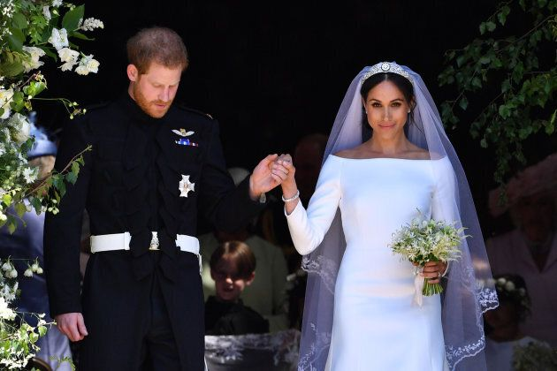 Britain's Prince Harry, Duke of Sussex and his wife Meghan, Duchess of Sussex leave from the West Door...