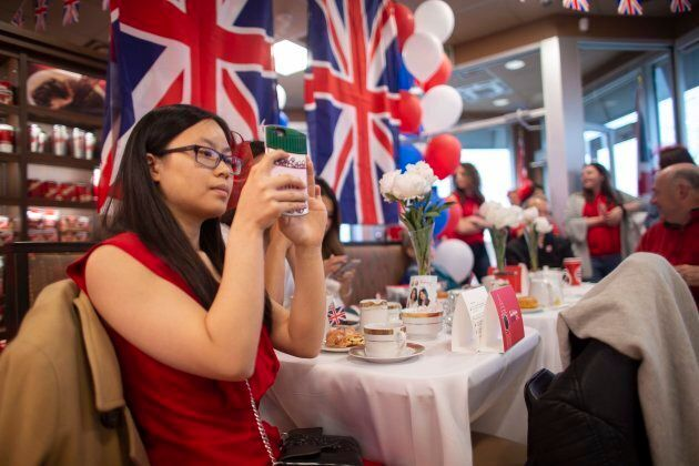 Samantha Chiu and other fans of the royals gather at a Tim Hortons in London, Ont., to watch the wedding...
