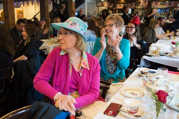Royal fans react as they watch the royal wedding of Prince Harry and Meghan Markle at a bar in Montreal...