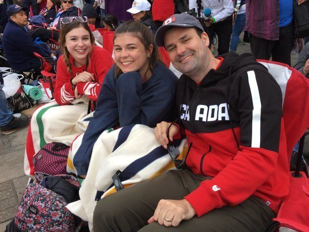 Pat Hart, right to left, poses with his daughters Camille and Charlotte as they camp along the procession...