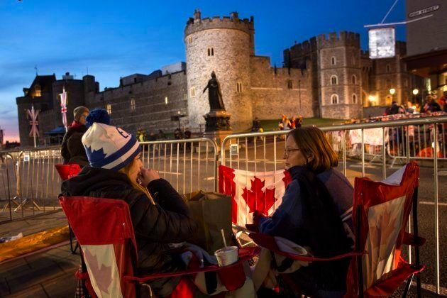 A group of woman from Canada sit outside Windsor Castle, England on