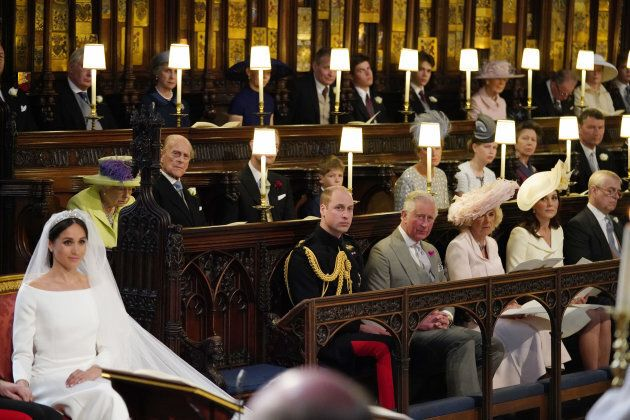 The Queen and Prince Philip are seen in the second row of the
