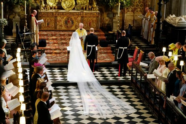 Prince Harry and Meghan Markle stand at the altar together at St. George's Chapel.