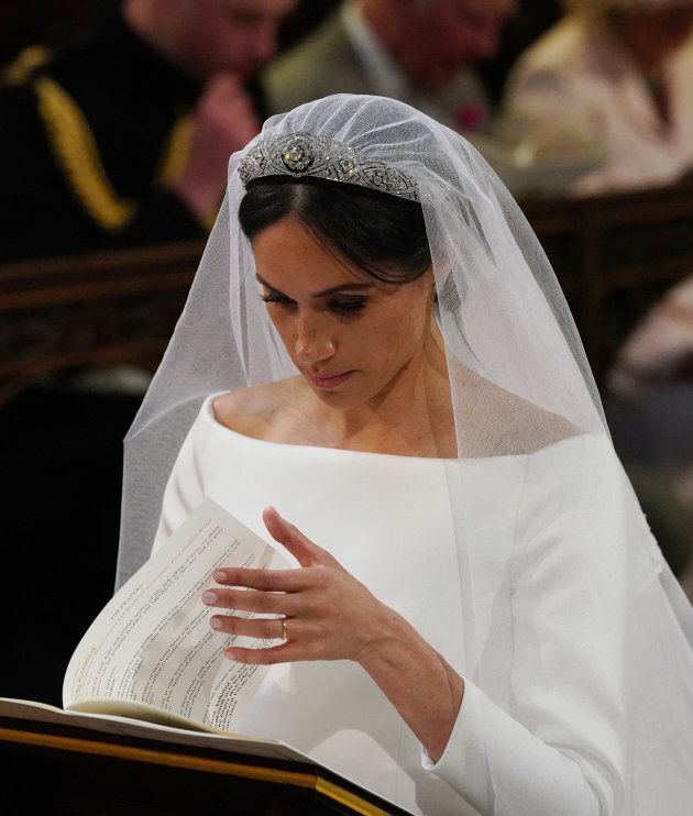 Meghan Markle at the High Altar during her wedding to Britain's Prince Harry, Duke of Sussex in St George's...