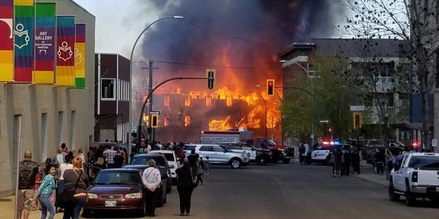 A building in downtown Brandon, Man. is engulfed in flames on May 19,