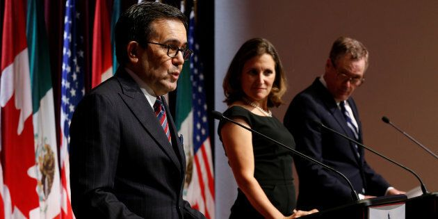 Mexico's economy minister, Ildefonso Guajardo (L), addresses the media with Canadian Foreign Minister...