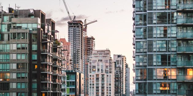 A neighbourhood of high-rise condo buildings in downtown Vancouver. New research suggests Canadians who live in more dense, more expensive neighbourhoods tend to be less happy than those in rural areas.