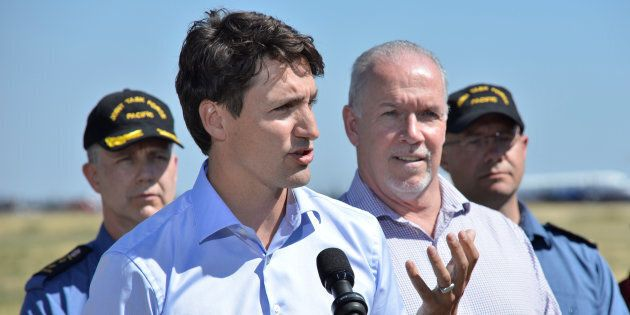 Prime Minister Justin Trudeau, accompanied by British Columbia's Premier John Horgan, addresses the media...