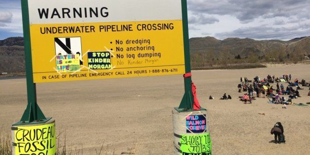 """People rally at a """"Picnics not Pipelines"""" event in Kamloops, B.C. on April 22, 2018."""