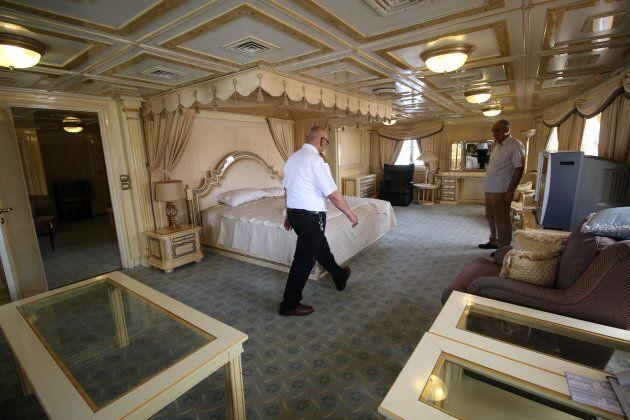 A captain walks inside the yacht called