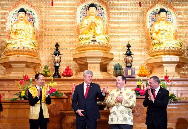 Stephen Harper takes part in the 2015 Chinese New Year Festival with Jason Kenney at the Fo Guang Shan Temple of Toronto in Mississauga, Ont. on Feb. 20, 2015.