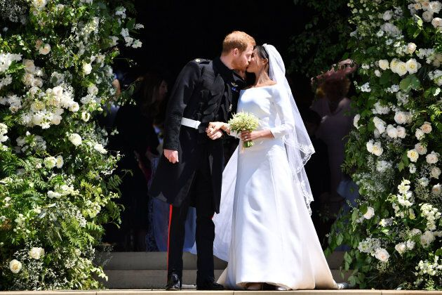 Prince Harry and Meghan Markle kiss as they leave at St. George's Chapel in Windsor Castle after their...