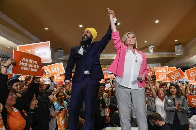 Federal NDP leader Jagmeet Singh welcomes provincial NDP leader Andrea Horwath to the stage at an NDP rally in Brampton, Ontario on May 21, 2018.