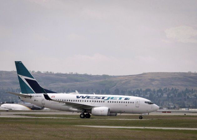 WestJet planes are seen at the Calgary Airport in Calgary on May 10,