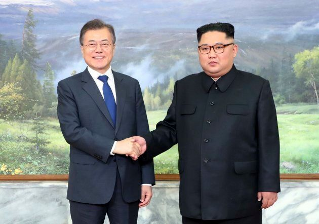 In this photo provided by South Korea Presidential Blue House via Yonhap News Agency, North Korean leader...