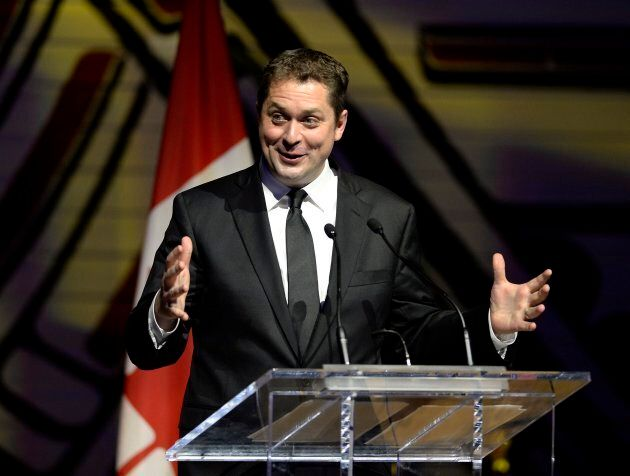 Conservative Leader Andrew Scheer jokes during his speech at the Parliamentary Press Gallery Dinner at...