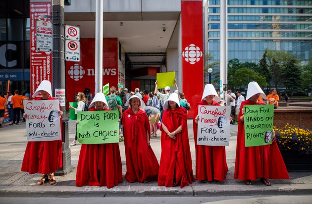 Abortion rights activists dressed up as characters from
