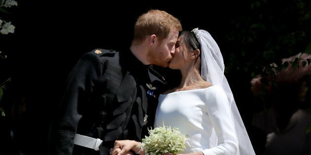 Prince Harry and Meghan Markle kiss outside St George's Chapel in Windsor Castle after their wedding on May 19, 2018.