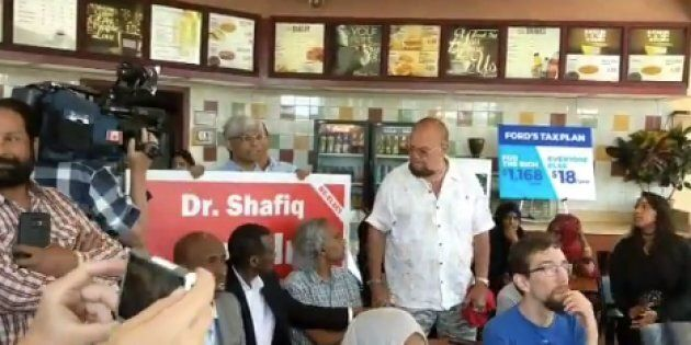 Ontario Liberal candidate Shafiq Qaadri appeared at an NDP press conference holding one of his campaign