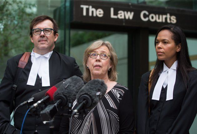 Green Party Leader Elizabeth May is flanked by her lawyers Alexander Ejsmont and Andi Mackay as she speaks...