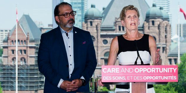 Ontario Liberal leader Kathleen Wynne speaks to the media while making a campaign stop in Toronto on...