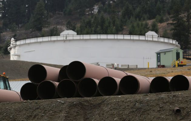 Replacement pipe is stored near crude oil storage tanks at Kinder Morgan's Trans Mountain Pipeline terminal...
