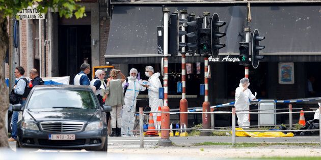 Police officers and forensics experts are seen on the scene of a shooting in Liege, Belgium, May 29,