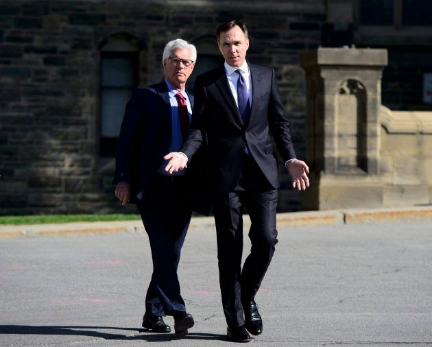 Natural Resources Minister James Carr, left, and Finance Minister Bill Morneau leave a cabinet meeting...