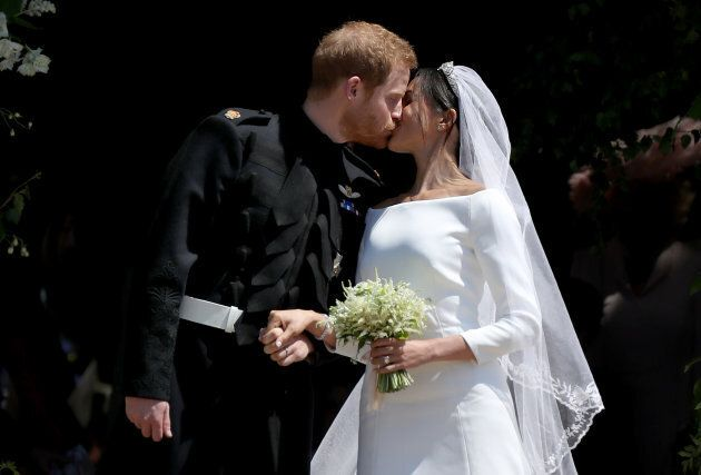 Prince Harry and Meghan Markle kiss outside St George's Chapel in Windsor Castle after their wedding...