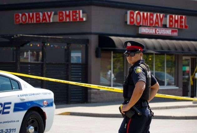 A Police officer stands watch at the scene of an explosion at a restaurant in Mississauga, Ont. on May...