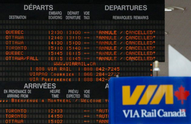 A sign board showing cancelled Via Rail trains is seen at Central Station in Montreal July 24,
