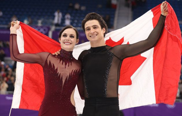 Gold medallists Tessa Virtue and Scott Moir celebrate at the Pyeongchang 2018 Winter Olympics in Gangneung,...