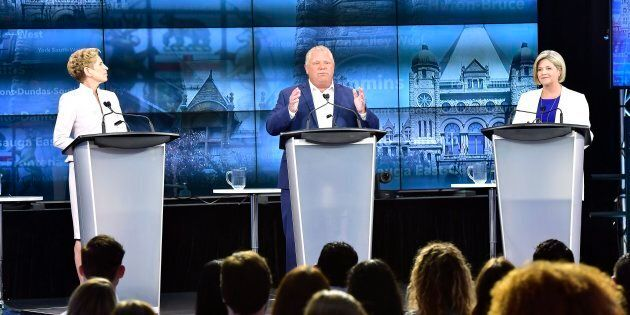 Ontario Progressive Conservative Leader Doug Ford, centre, speaks as Ontario Liberal Leader Kathleen Wynne, left, and Ontario NDP Leader Andrea Horwath look on during the third and final televised debate of the provincial election campaign in Toronto on May 27, 2018.