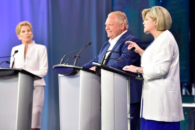 Ontario Liberal Leader Kathleen Wynne, left to right, Ontario Progressive Conservative Leader Doug Ford and Ontario NDP Leader Andrea Horwath participate during the third and final televised debate of the provincial election campaign in Toronto on May 27, 2018.