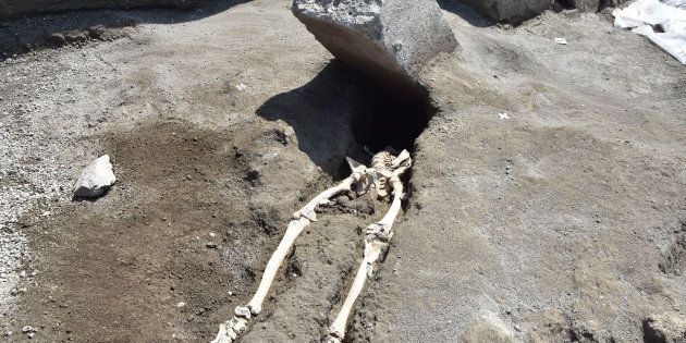 A skeleton of a victim recently found in the new work area of Regio V in the archaeological site of Pompeii,...