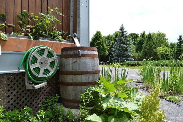 Rain barrel installed at The Ecoological Solar House located on the Saint Helen's Island, Montreal, Canada.