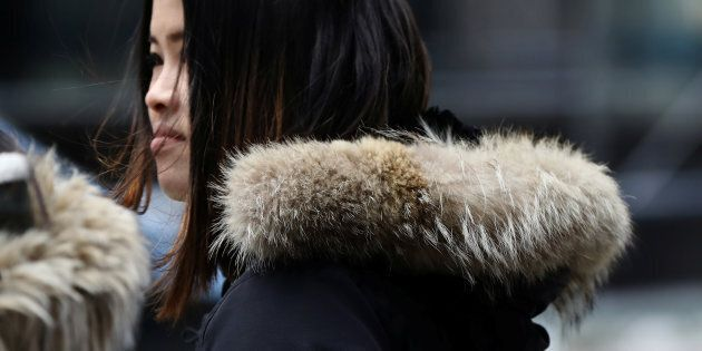 A woman wears a Canada Goose jacket in New York City's Times Square, March 16, 2017. Canada Goose is...