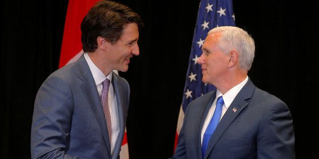 Prime Minister Justin Trudeau and United States Vice President Mike Pence meet on the sidelines of the...