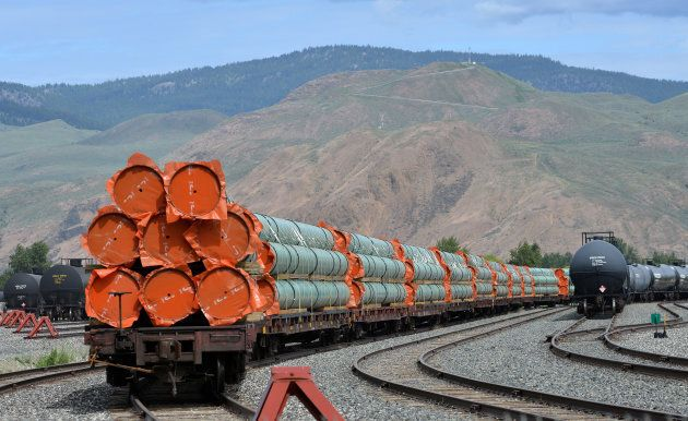 Steel pipe to be used in the oil pipeline construction of Kinder Morgan Canada's Trans Mountain Expansion Project sit on rail cars at a stockpile site in Kamloops, B.C., on May 29, 2018.