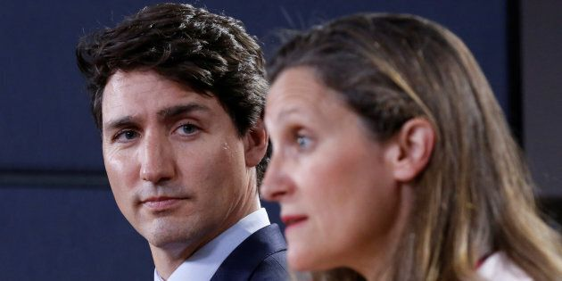 Canada's Prime Minister Justin Trudeau listens to Foreign Minister Chrystia Freeland during news conference...