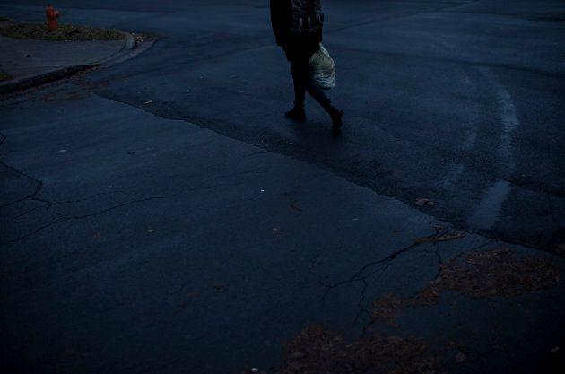 A pedestrian near the neighbourhood on Gladstone Street in Halifax on Dec. 11,