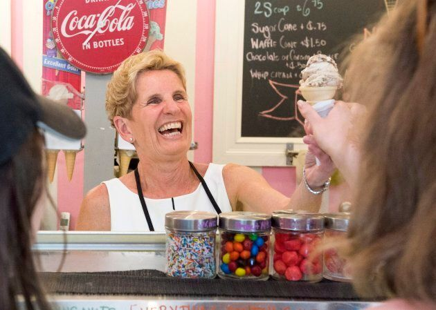Ontario Liberal Leader Kathleen Wynne serves ice cream during a campaign stop in Toronto on