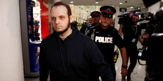 Joshua Boyle walks through the airport after arriving with his wife and three children at Toronto Pearson...