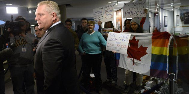Doug Ford takes questions from the media outside his brother Toronto Mayor Rob Ford's office at Toronto...