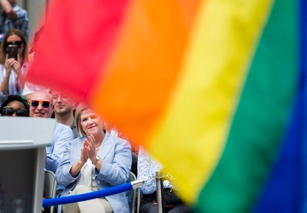 Ontario NDP leader Andrea Horwath listens to Toronto Mayor John Tory speak as she attends the rainbow...