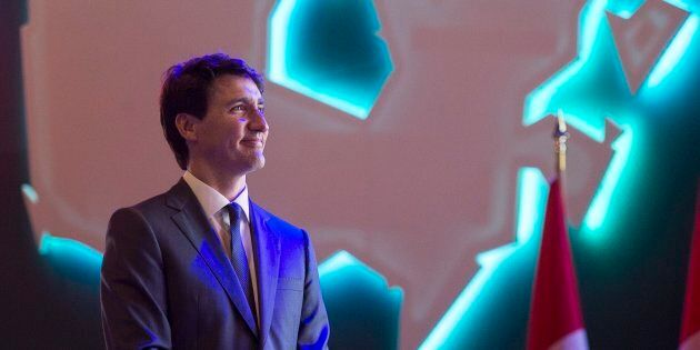 Prime Minister Justin Trudeau watches a video as he delivers a keynote address at the Federation of Canadian...
