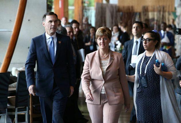 Canada's Minister of Finance Bill Morneau and Minister of International Development Marie-Claude Bibeau...