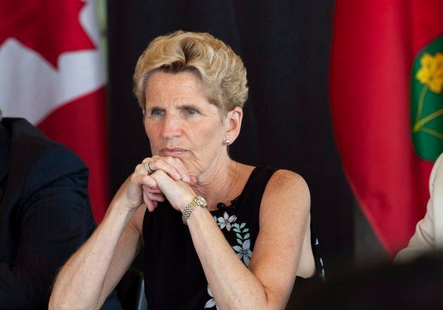 Ontario Liberal Party Leader Kathleen Wynne listen to students at the University of Waterloo during a campaign stop in Waterloo, Ont., on Friday.